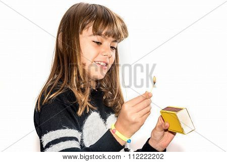 Eight Year Old Girl Playing With Matches