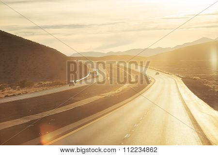 Photo of highway at sunset
