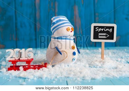 Spring wooden sign with snowman, sled and word 2016. New year travel concept