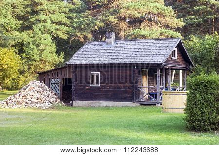 Small Wooden Bathhouse In A Rural Homestead