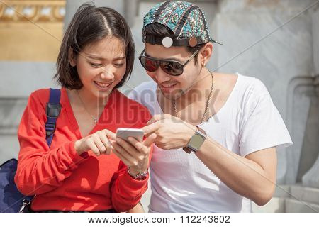 Young Man And Woman Looking To Smart Phone Screen Use For Modern People Lifestyle In Digital Technol