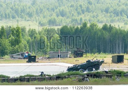 BTR-82A armoured personnel carrier exits from water