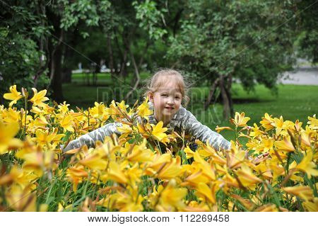 The Girl Embraces Beautiful Flowers In Park