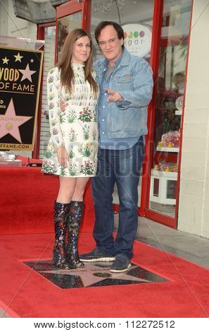 LOS ANGELES - DEC 21:  Courtney Hoffman, Quentin Tarantino at the Quentin Tarantino Hollywood Walk of Fame Star Ceremony at the Hollywood Blvd on December 21, 2015 in Los Angeles, CA