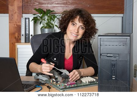 Woman Is Fixing A Computer Hard Drive