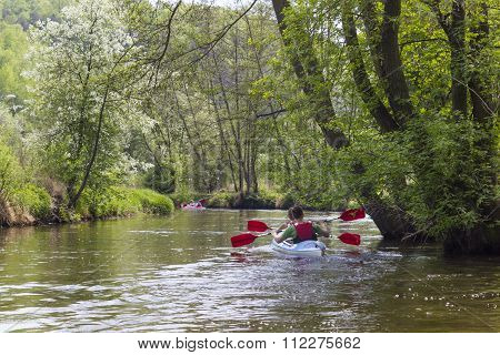 Kayaking on the river Kamienna near Baltow, Poland