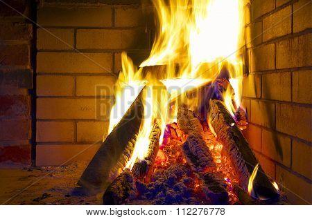 Burning Logs In Fireplace.