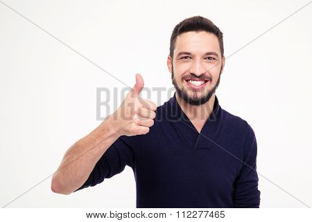 Cheerful attractive bearded man smiling and showing thumbs up over white background