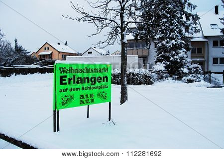 Erlangen Germany - DECEMBER 18: Christmas market singboard in Erlangen in a snow covered residetial street on 18 December 2010 in Erlangen German as editorial