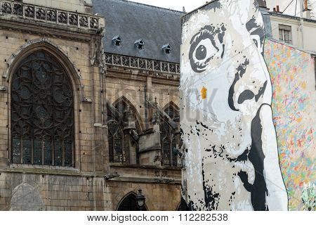 PARIS, FRANCE - SEPTEMBER 11, 2014: Paris - The wall filled with mural near Pompidou Centre