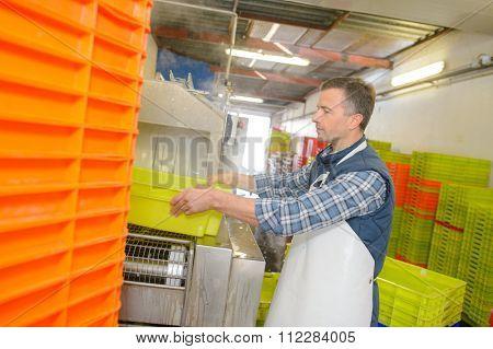 Man moving crates