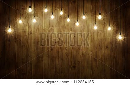 Light bulbs on dark wooden background