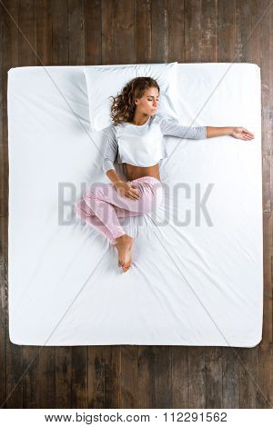 Top view photo of sleeping girl