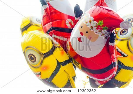 Santa and minions baloons isolated