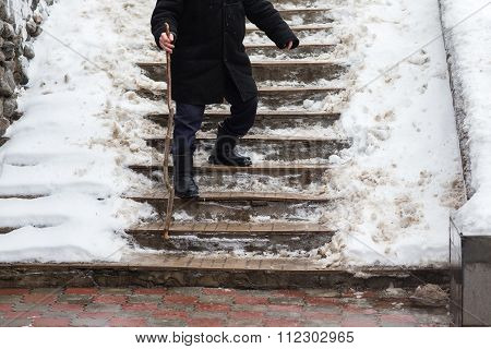 The Old Man Down The Stairs Slippery In Winter