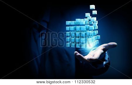 Businesswoman hand shows cube as symbol of problem solving