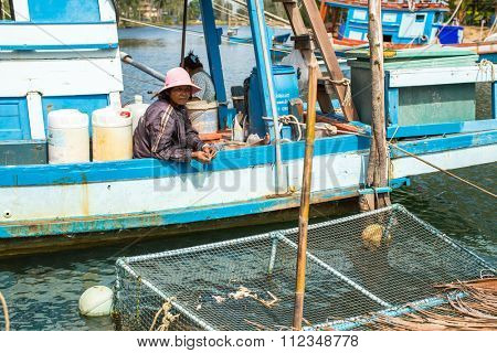 KOH CHANG - THAILAND - DEC 22, 2015: Unidentified local woman in fisherman's village. Island is on Gulf of Thailand, near border with Cambodia, population of 5356 people living in 8 villages.