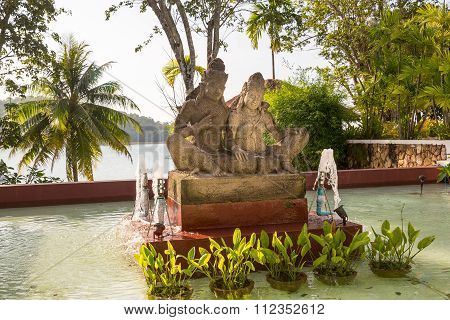 Statue on island of Phuket Thailand. Thai style statues acting Wai (or Sawasdee)