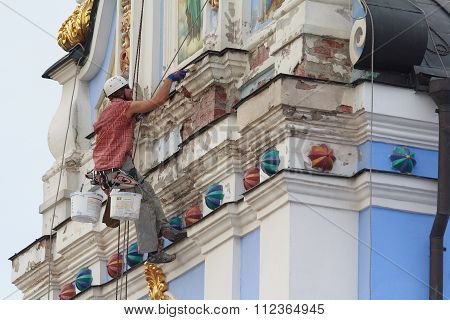 Kiev, Ukraine - September 04, 2015: Worker-restorer Working At Height Repair Michael's Monastery