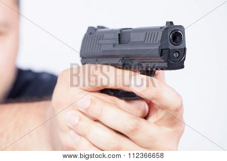 Pointing Gun. Focus On The Gun