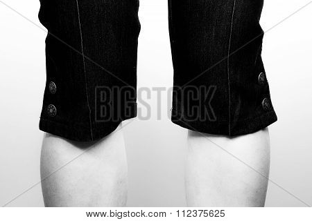 Isolated pair of female knees in buttoned breeches