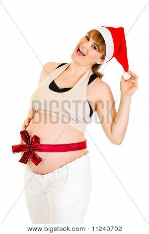 Happy beautiful pregnant woman in Santa hat with red ribbon on belly isolated on white