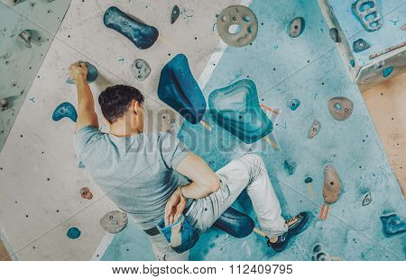 Climber Coating His Hand In Magnesium