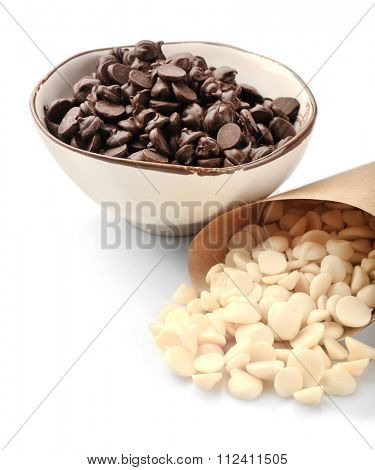 Chocolate morsels, close-up, isolated on white