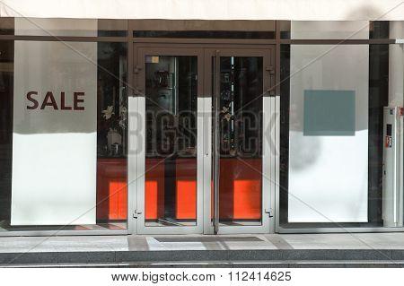 Inscription On A Shop Window Sale