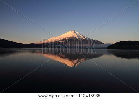 Mt. Fuji in Red (Red Fuji) view from Yamanaka lake in Yamanashi Japan