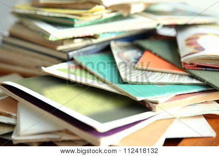Books and magazines background, close up