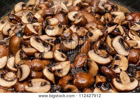 Chesnut Mushrooms In Frying Pan.