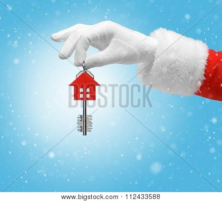 Hand In Costume Santa Claus Is Holding House Keys