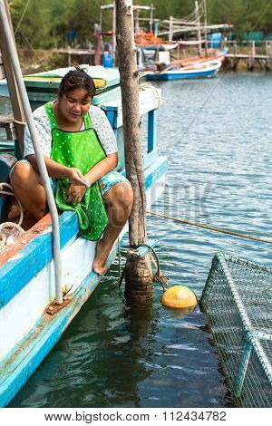 KOH CHANG - THAILAND - CIRCA DEC, 2015: Unidentified local woman in fisherman's village. Island is on Gulf of Thailand, near border with Cambodia, population of 5356 people living in 8 villages.