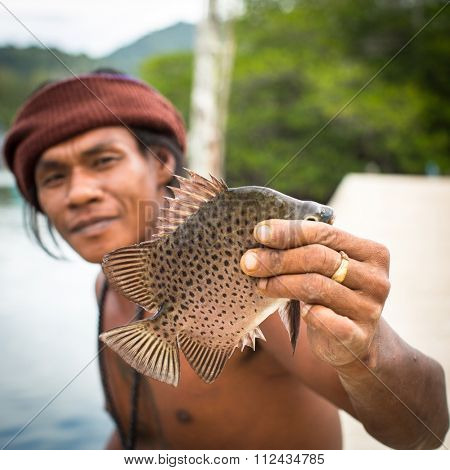 KOH CHANG - THAILAND - CIRCA DEC, 2015: Unidentified local man in fisherman's village. Island is on Gulf of Thailand, near border with Cambodia, population of 5356 people living in 8 villages.