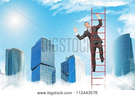 Happy businessman climbing ladder in sky