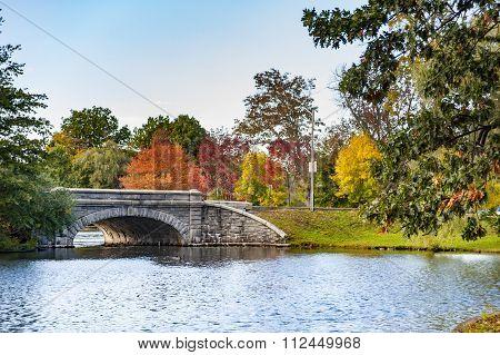 Stone Bridge Spanning Pond