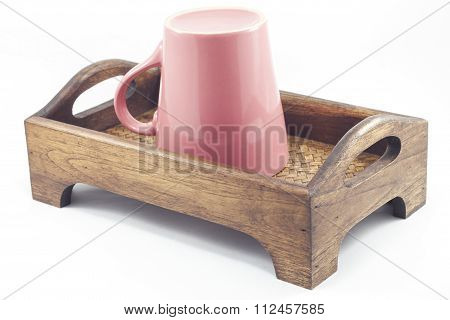 Pink Mug On Wooden Tray Isolated On White Background