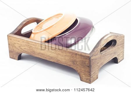 Plates On Wooden Tray Isolated On White Background
