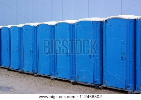 A line of portable toilets