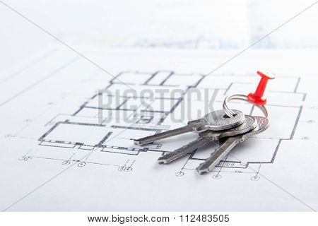 Model house, construction plan for house building, keys, divider compass and clipboard. Real Estate