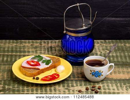 Breakfast With A Sandwich And Black Coffee