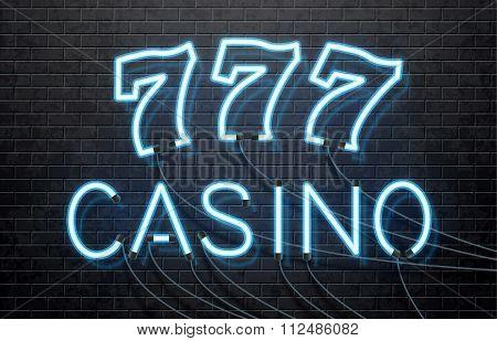 neon casino isolated on black brick wall