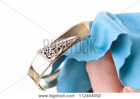 Polishing jewelry with a cloth