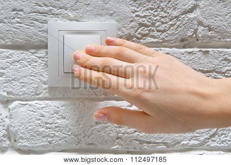 Finger turning white light switch on or off