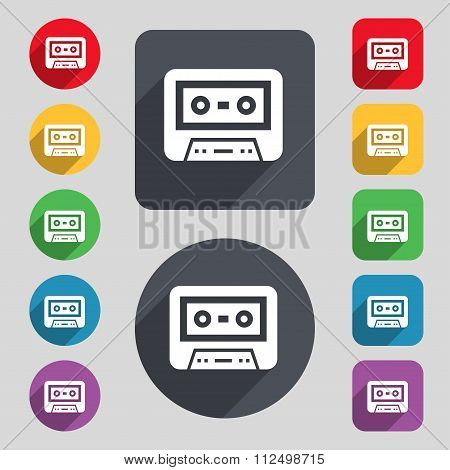 Audiocassette Icon Sign. A Set Of 12 Colored Buttons And A Long Shadow. Flat Design.