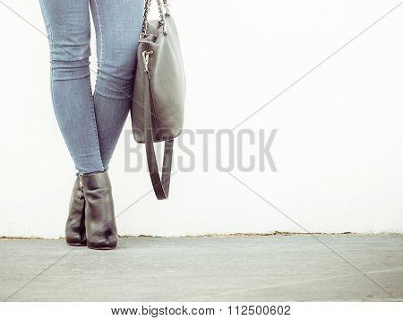 Woman In High Heels Shoes Holds Handbag