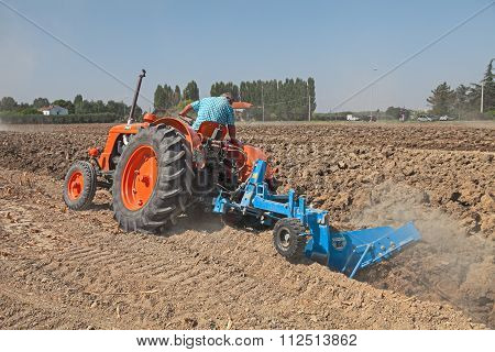 Farmer Plowing The Field With An Old Tractor Fiat 80 R