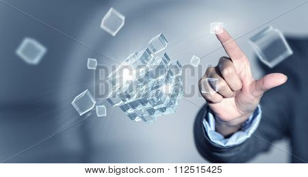 Businesswoman touching with finger cube as symbol of problem solving