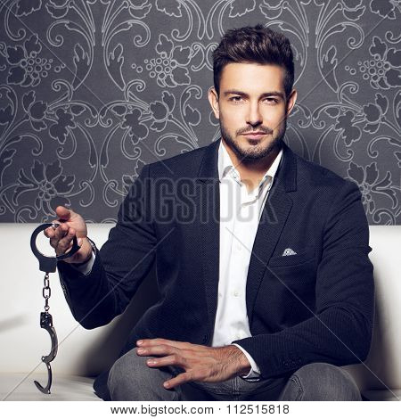 Sexy Man Holding Handcuffs